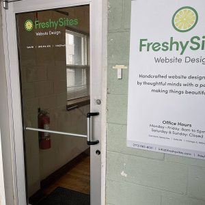 FreshySites lobby with poster in Chicago, IL office